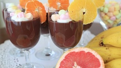 Chocolate pudding with whipped cream and fruits Stock Footage