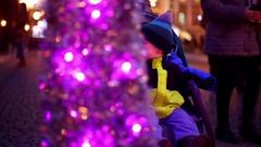 Christmas illuminations baby boy looking street Stock Footage