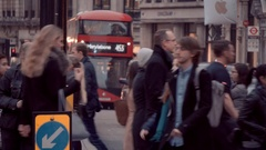 Crowd of people crossing Oxford street - a busy place in London Stock Footage