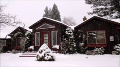 Winter scene,  old house and street with snow falling Stock Footage