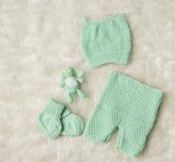 Newborn Baby Clothing, New Born Kids Hat Socks Booties Trousers Shoes on Whit Kuvituskuvat