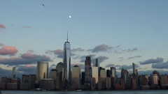 Time-lapse video of the moon rising at sunset next to the World Trade Center Stock Footage