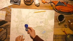 Traveler, tourist using сompass and hiker map. Top view. Stock Footage
