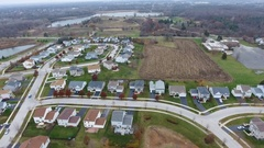 Aerial view of houses in a suburban rural community Stock Footage