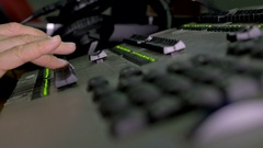 Hand of the sound producer on the mixing console Stock Footage