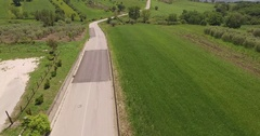 Aerial 4k drone shot above small italian street flying at a beautiful landscape Stock Footage