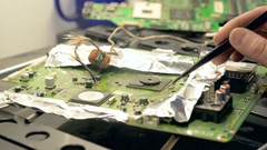 Soldering and reparing electronic circuit board Stock Footage