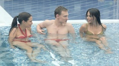 Young people enjoying the hot tub in the swimming pool Arkistovideo