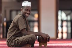 Black African Muslim Man Reading Holy Islamic Book Koran Kuvituskuvat