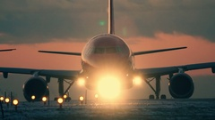 Aircraft preparing for takeoff at sunset. Airplane lights  backlit Stock Footage