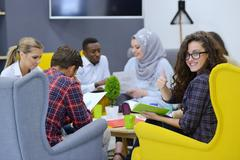 Group of young people, Startup entrepreneurs working on their venture in Stock Photos