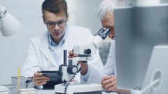 Senior Male Doctor Conducting Health Issue Investigation Through Microscope.  Stock Footage