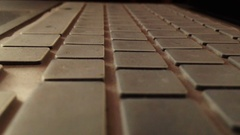 Selective focus of computer keyboard illuminated when start Stock Footage