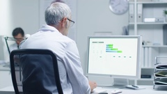 Senior Male Laboratory Researcher Working with Graphs on His Personal Computer.  Stock Footage