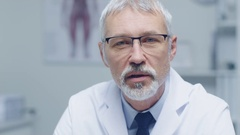 Close-up of a Experienced Gray Haired Senior Medical Practitioner Talking  Stock Footage