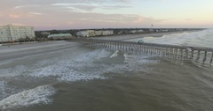 Aerial of Folly Beach Fishing Pier at Sunrise with Tides Resort Stock Footage