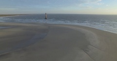 Aerial of Morris Island Lighthouse at Folly Beach Stock Footage