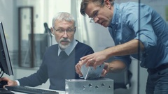 Two Senior Engineers Discuss Important Technical Component. Both are Experienced Stock Footage