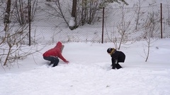 Mother and son throw up soft, fresh snow. Stock Footage