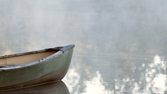Canoe on early morning lake with mist Stock Footage