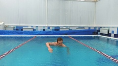 Young man swimming the front crawl in a pool Stock Footage