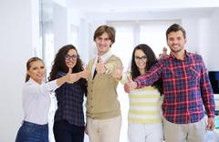 Laughing young business entrepreneurs in trendy clothing celebrating a success Stock Photos