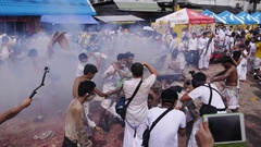 People Celebrating Vegetarian Festival with Firecrackers. Stock Footage