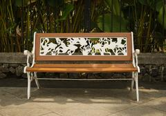 A bench made from wood and metal engraving white coloured photo taken in Stock Photos