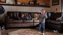 Family playing video game baby getting excited Stock Footage
