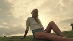 Blonde lifestyle model poses in a park and surfside in Miami Beach Stock Footage