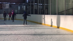 People Ice Skating in a Rink 4k Video Stock Footage
