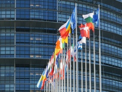 European Parliament building with  all European Union Flags waving in a row Stock Footage