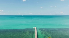 Green sea, pier and blue sky on a tropical island 1 Stock Footage