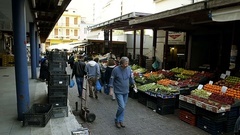 Panning over market stall selling vegetables and fruits at the Athens Central Stock Footage