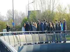 Group of kids taking group photo of the European Parliament building in Stock Footage