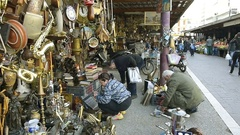 Woman buying vintage object at Greek flea market in Central Athens Market Stock Footage