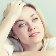 Portrait of a beautiful young woman. She thinks about the pleasant Stock Photos