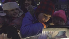 Mother With Children on Outdoor Ice Skating Rink Stock Footage
