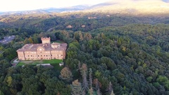 Aerial shot, gorgeous italian castle, with the sun behind, filmed with .. Stock Footage
