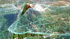 Broken glass that fell down on stone Stock Footage