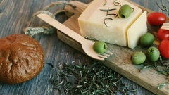 Parmesan cheese, green olives, rosemary, red cherry tomatoes Stock Footage