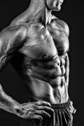 Beautiful naked male torso against black background Stock Photos