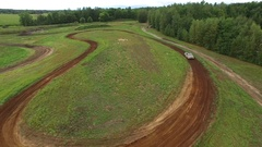 Aerial rally car takes corner 4k Stock Footage