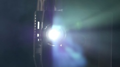 Moving away from objective lens film projector. Close up Stock Footage