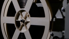 Projector that turns the film reel. Side view Stock Footage