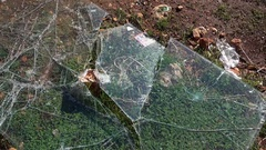 Glass broken to pieces on the ground Stock Footage