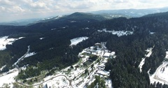 Panoramic shot of a small town in the winter mountains Stock Footage