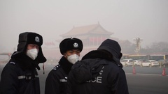 Policemen wear masks to prevent breathing in toxic air particles in heavy haze Stock Footage