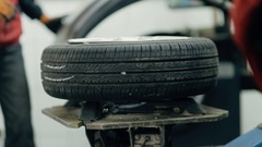 Inflating car tire. Auto mechanic controls the pressure. Stock Footage