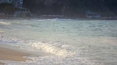 Bay beautiful sandy beach water splash waves wash up sea shore summer low motion Stock Footage